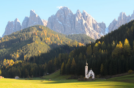 odle: The church of San Giovanni in Ranui St. Johann in front of the Odle Odle or dolomites mountain peaks in Santa Maddalena St. Magdalena in the Val di Funes Italy.
