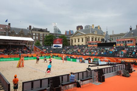 beach volleyball: The Hague, The Netherlands - June 28, 2015: Beach Volleyball match between Canada and France in the stadium in The Hague, The Netherlands floating on Hofvijver lake with the Mauritshuis museum in the background constantly the 2015 World Championships.