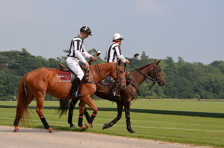 arbitrator: CIRENCESTER, UK - AUGUST 25: Two horse polo umpires On Their horses at the Cirencester Park Polo Club in Cirencester, UK on August 25, 2013.