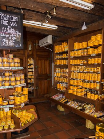 canard: Domme, France - August 27, 2015: A wooden store interior with a sale in cans and jars with foie gras goose liver in the Perigord, Dordogne region in France. Foie gras is an important ingredient in the French cuisine and traditionally eaten at Christmas in Editorial