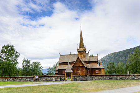 stave: The historic wooden stave church of Lom, dating from the twelfth century, a tourist attraction in Oppland, Norway. Stock Photo