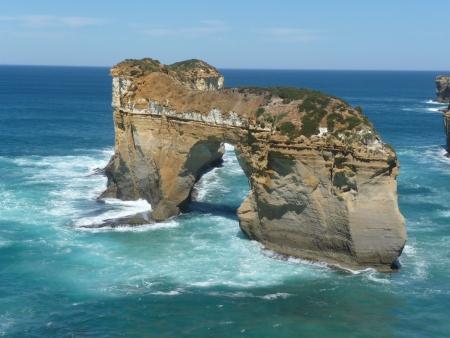 rock arch: Limestone rock arch in the sea right off the coast  Stock Photo