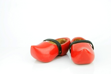 Red wooden shoes   Dutch clogs with a black leather strap  Traditional Dutch footwear for farmers  photo