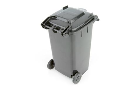 wheelie bin: Grey garbage wheelie bin with a closed lid on a white background