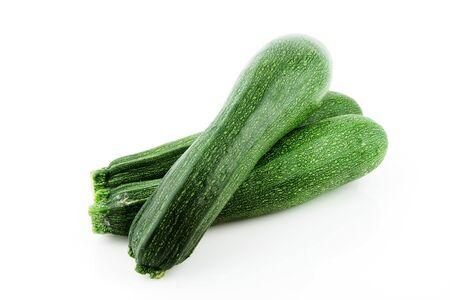 cucurbita: A stack of zucchini   courgette  Cucurbita pepo  on a white background