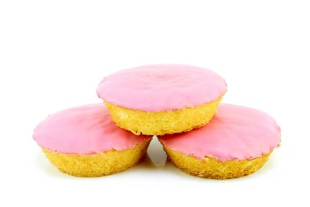 roze: Typical dutch pastry called  roze koek  pink cake   Its a flat cake with fondant glazing, on a white background