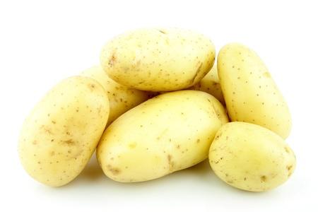 tuberosum: A bunch of potatoes Solanum tuberosum  on a white background