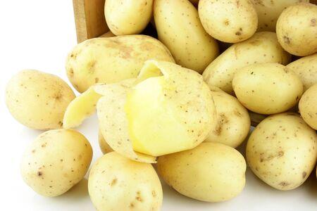 tuberosum: A crate of potatoes Solanum tuberosum  on a white background