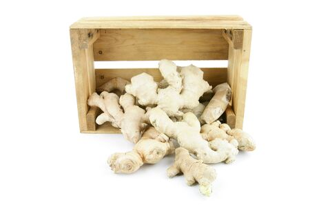 Ginger root  Zingiber officinale  in a wooden crate  photo