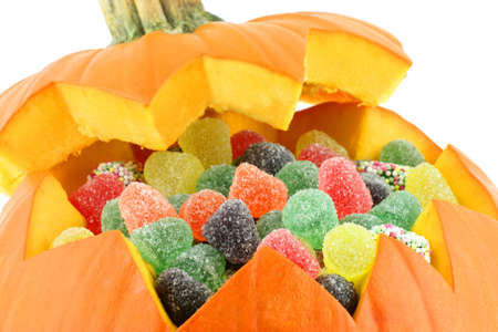 A opened pumpkin with candy inside  photo