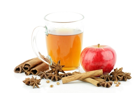 cider: A glass of tea with apple and spices,on a white background  Stock Photo
