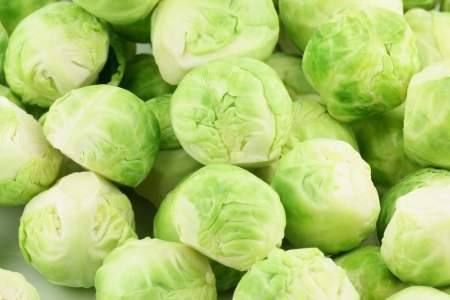 brussels sprouts: A pile of fresh green brussels sprouts  Brassica oleracea , background  Stock Photo