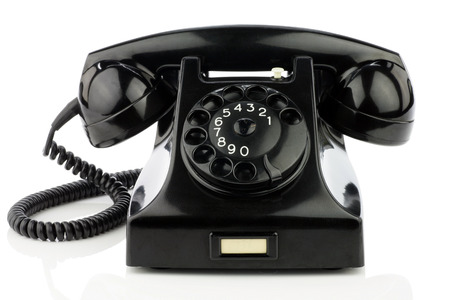 Old retro bakelite telephone  On a white background