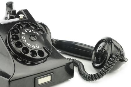 Old retro bakelite telephone  On a white background photo