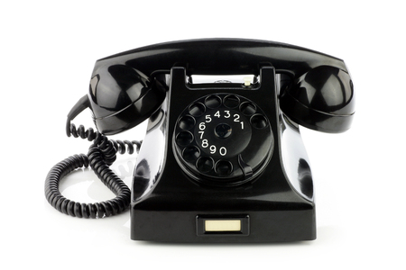 bakelite: Old retro bakelite telephone. On a white background.