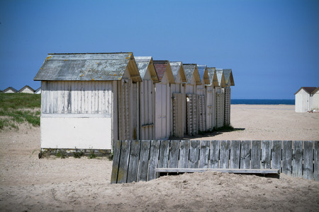 white beach cabin in Ouistreham in Normandy also called sword beach.