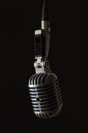Elvis microphone photographed in front of a black background Stock fotó