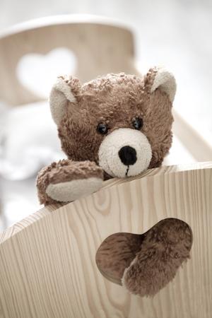 teddy bear sitting in a crib