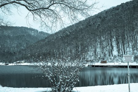 Pond in front of winter mountain landscape Stock Photo