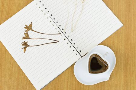 flores secas: Notebooks, coffee and dried flowers. Memories of Love concept record.