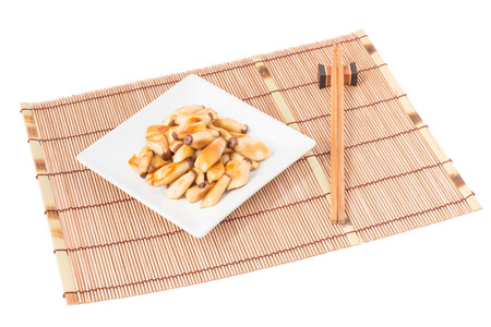 placemats: Fried king oyster mushrooms, eringi mushrooms with butter in ceramic dish on Placemats bamboo