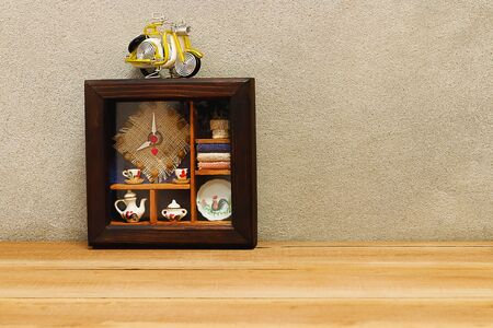 dial plate: Wood frame clock and motorcycle model on wooden table with copy space Stock Photo