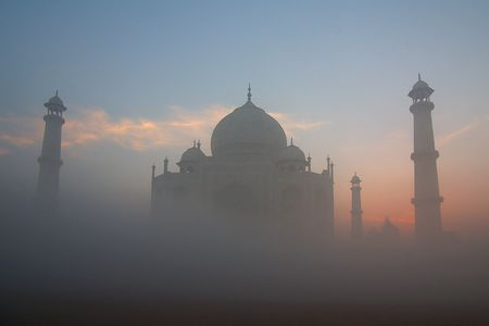 Taj Mahal in a fog on sunrise. Stock Photo - 8207954