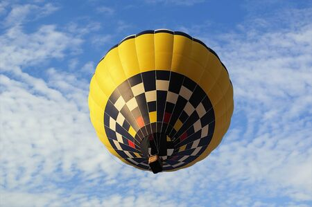 Hot-air balloon on the bsckground of the blue sky. photo