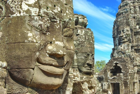 Stone head on towers of Bayon temple in Angkor Thom photo