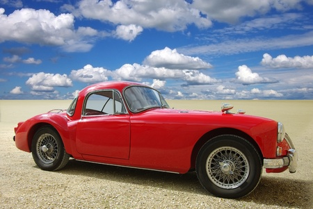 Classic red cabriolet on a background of the blue sky   Stock Photo - 13112986