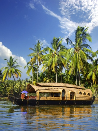 Houseboat in backwaters in India photo