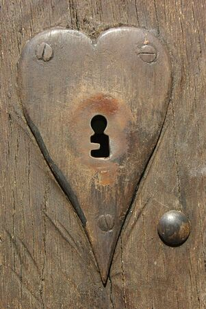 keyholes: Close-up fragment of ancient door with lock- keyhole  Stock Photo