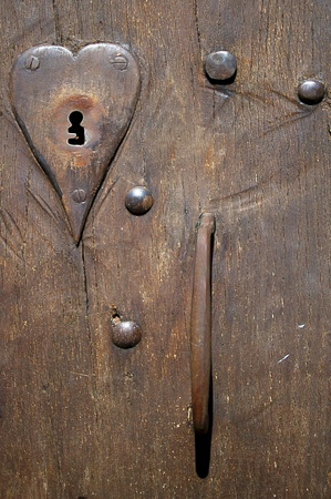 Close-up fragment of ancient door with lock- keyhole  Stock Photo