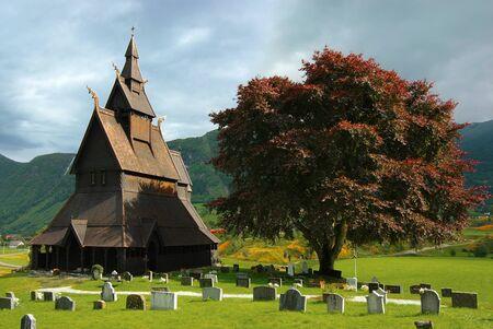 Autumn Norway landscape with stavkirke Stock Photo