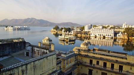 sunrise lake: View on the Pichola lake and Palas in Udajpur, India.