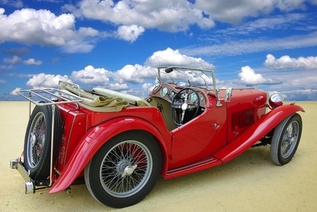 Classic red cabriolet on a background of the blue sky   Imagens