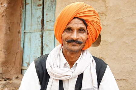 MANDU, INDIA- January 25, 2012- Portrait of a old Indian man with turban at Hampi. Mandu, India.