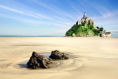 Mont Saint Michel with boulders in the foreground   France