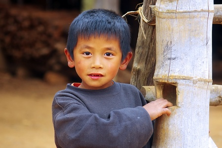 LAT SEN, LAOS- JANUARY 11: Portrait of a boy from the Lat Sen village near Plain of Jars. January 11, 2011 in Lat Sen,  Laos Stock Photo - 13574255