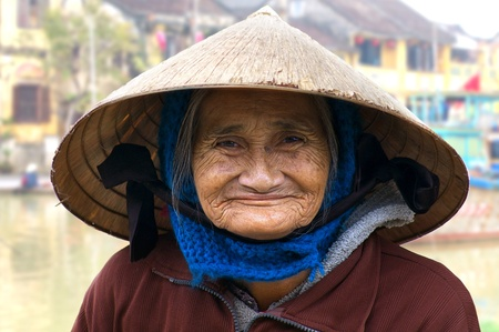 HOI AN, VIETNAM- JANUARY 17: Portrait of the old woman on a street in Hoi An. January 17, 2011 in Hoi An, Vietnam