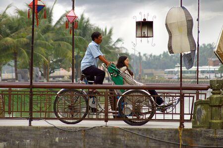 HOI AN, VIETNAM-JANUARY 17: A special way to the movement of tourists in the Hoi An, Vietnam. January 17, 2011 in Hoi An, Vietnam