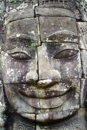 Stone head on towers of Bayon temple in Angkor Thom, Cambodia photo