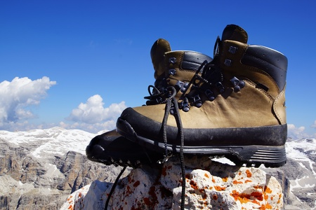 Mountain boots the background of the mountain landscape photo