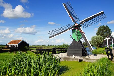 Picturesque landscape with windmills  Zaandijk, Netherlands Stock Photo - 15255470