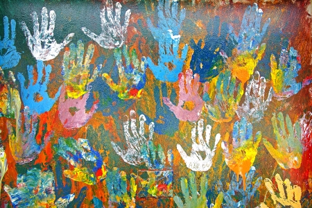 red palm oil: Background  Handprints made of multicolored oil paints