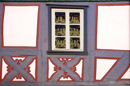 fachwerk: Background. Fragment of old fachwerk houses with window.