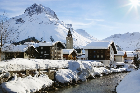 chalets: Picturesque winter landscape with river  Lech, Austria Stock Photo