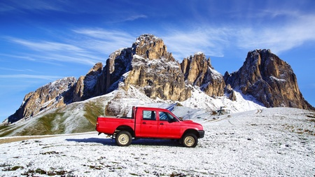 Red pickup near the Sella Pass  2244 m , Italy