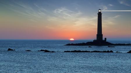 Landschap met Vuurtoren tijdens zonsondergang Bretagne, Frankrijk