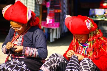 cai: Sa Pa, VIETNAM - January 02, 2011-The women with needlework at Sa Pa market.;